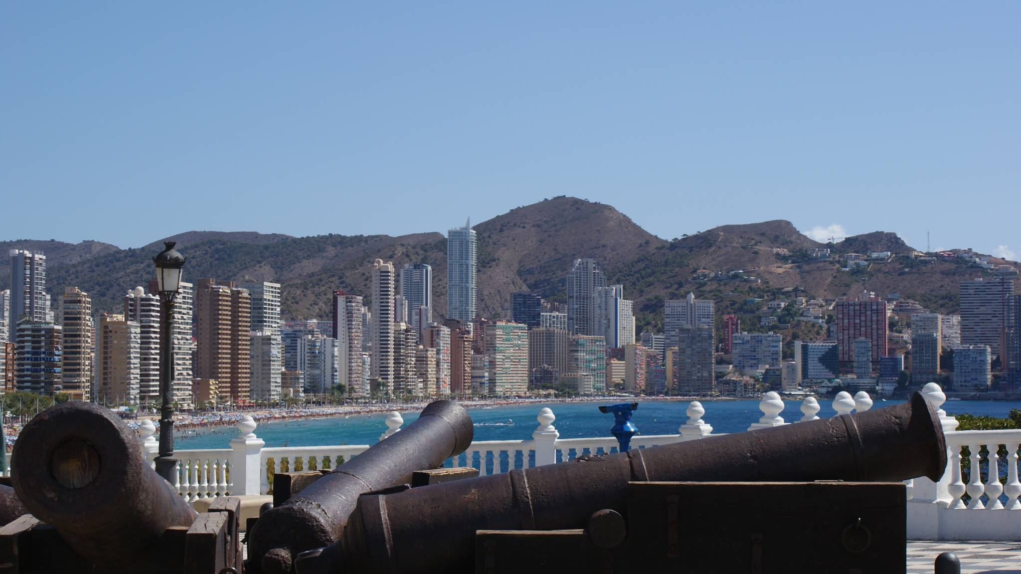 Cannons in Benidorm's Church Square and skyscrapers in the background